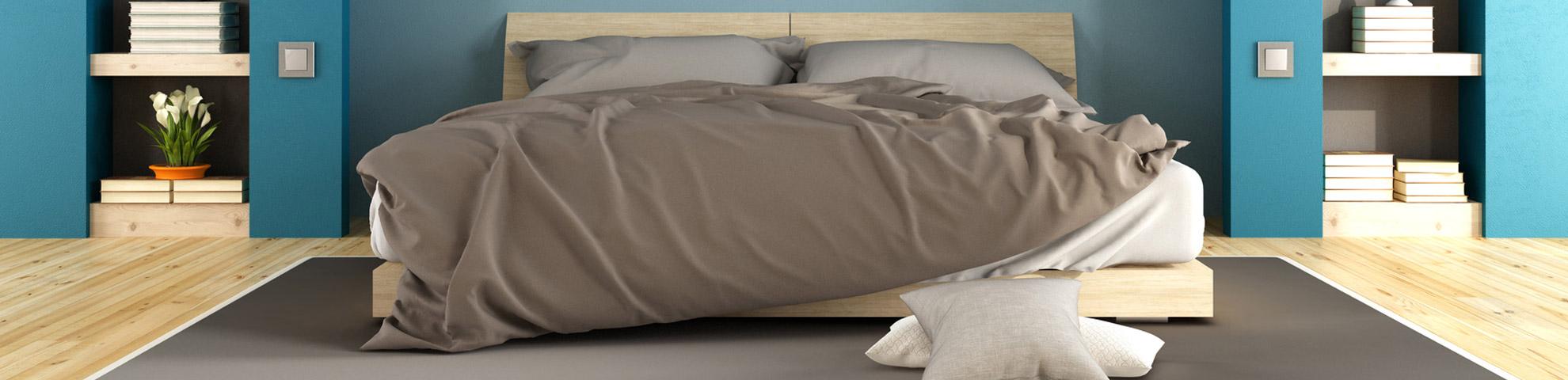 Ein Schlafzimmer mit Bett - Hintergrundbild 1 des Sliders der Seite Referenzen