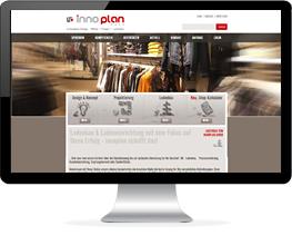Monitor mit der Website eines Unternehmens für Praxiseinrichtungen und Ladenbau